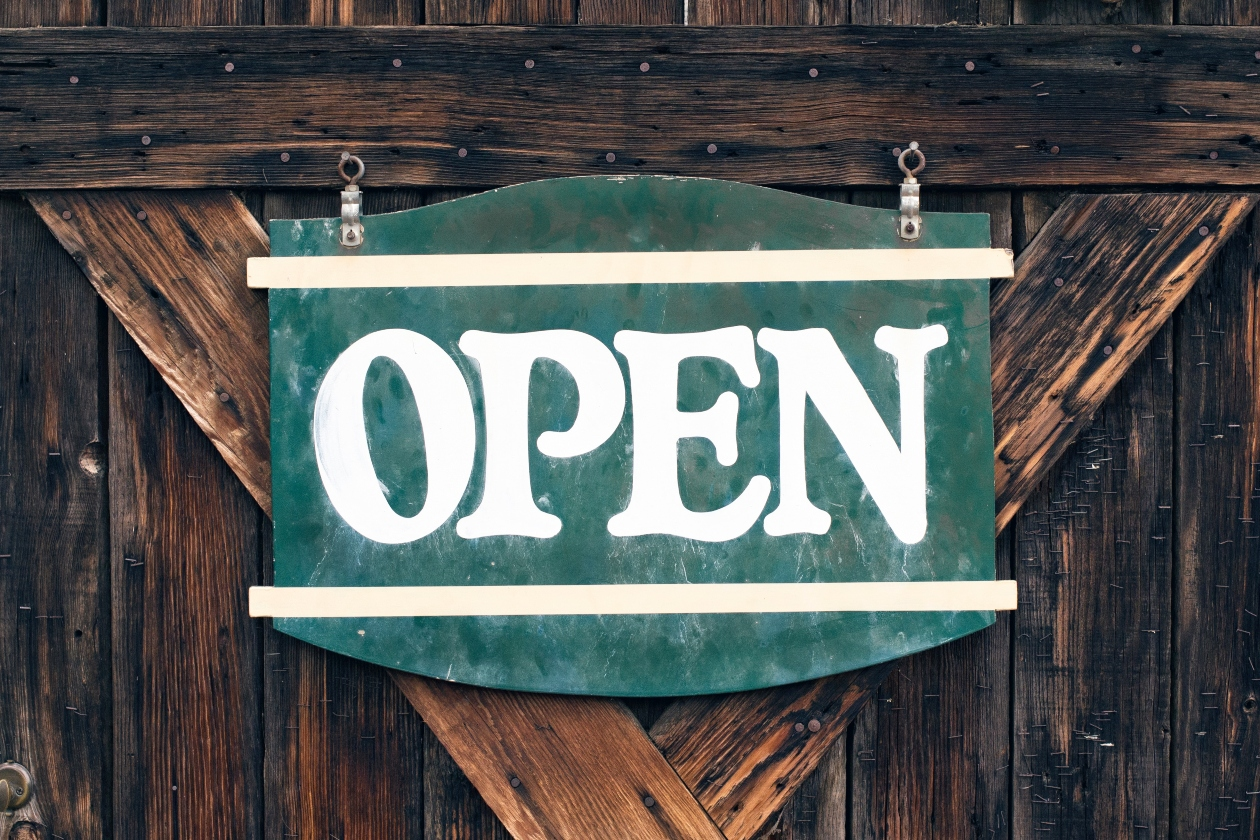 green-open-sign-on-wooden-door-white-font