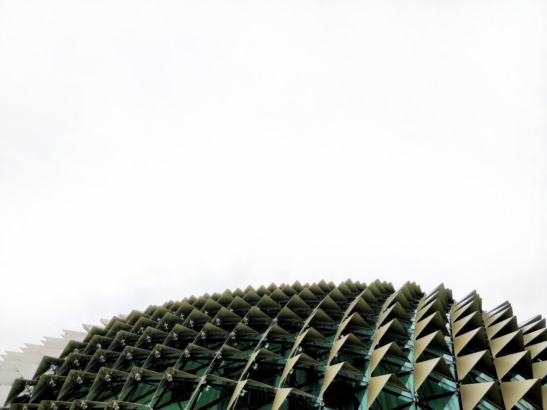 modern-building-green-with-pyramids-on-windows