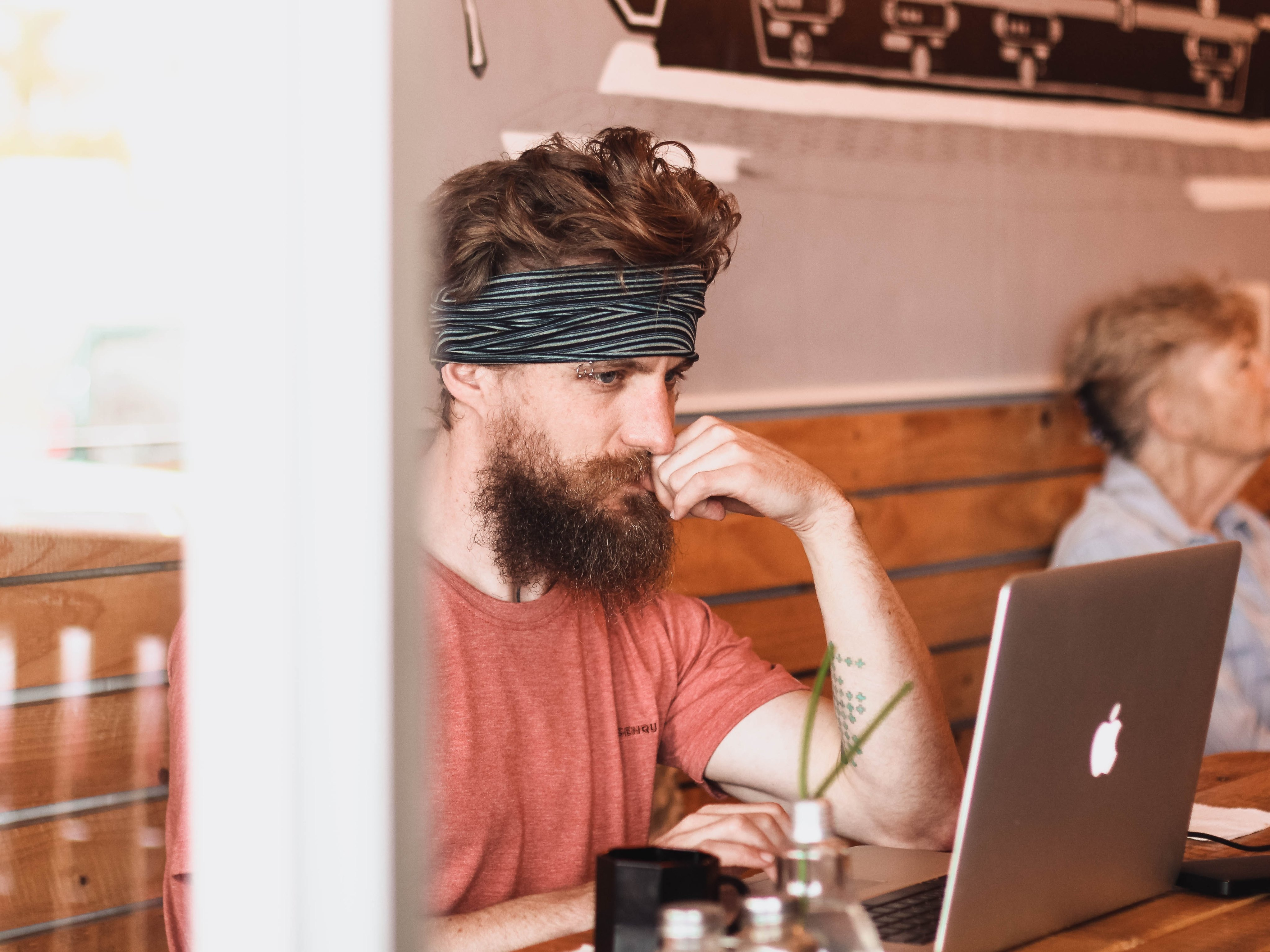Hipster developing mobile app on Computer