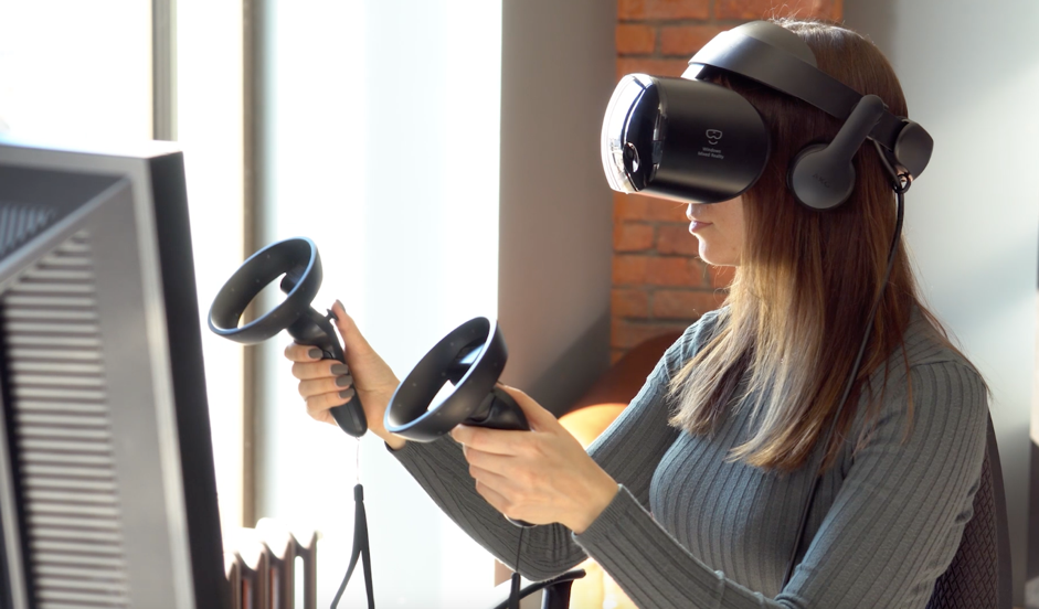 Woman playing vr game with handset