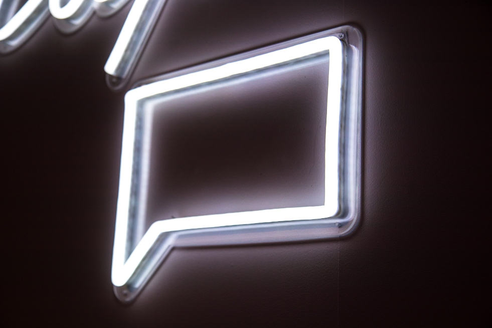 message-in-neon-white-sign