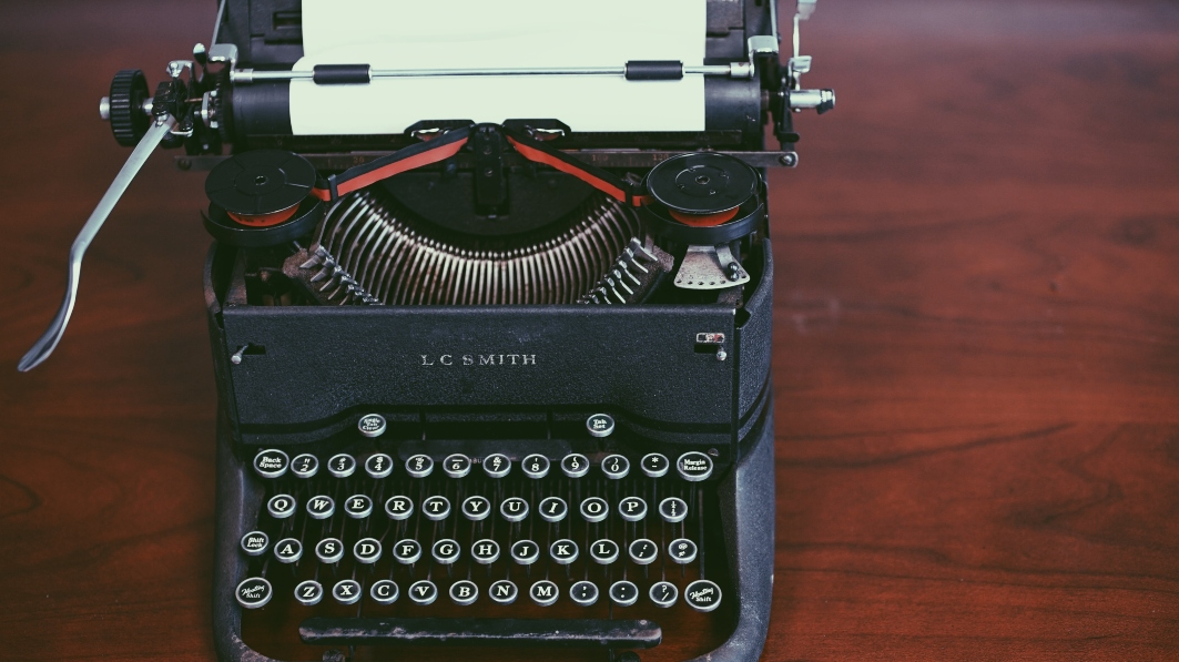 old-type-writer-with-paper-in-ream