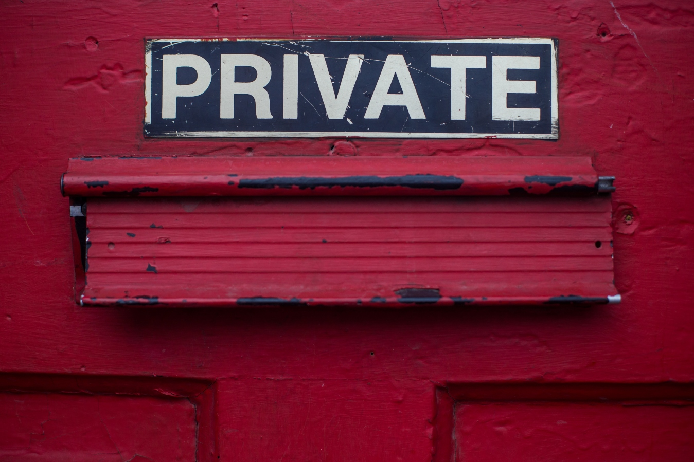 private-sign-above-red-door