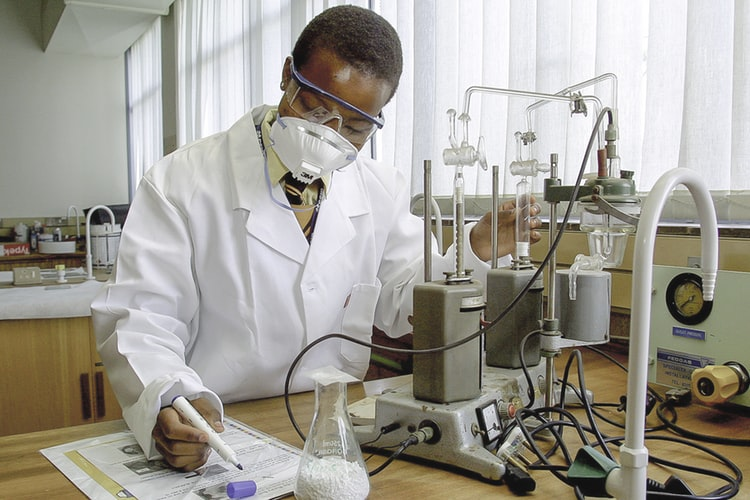 young person in a science lab