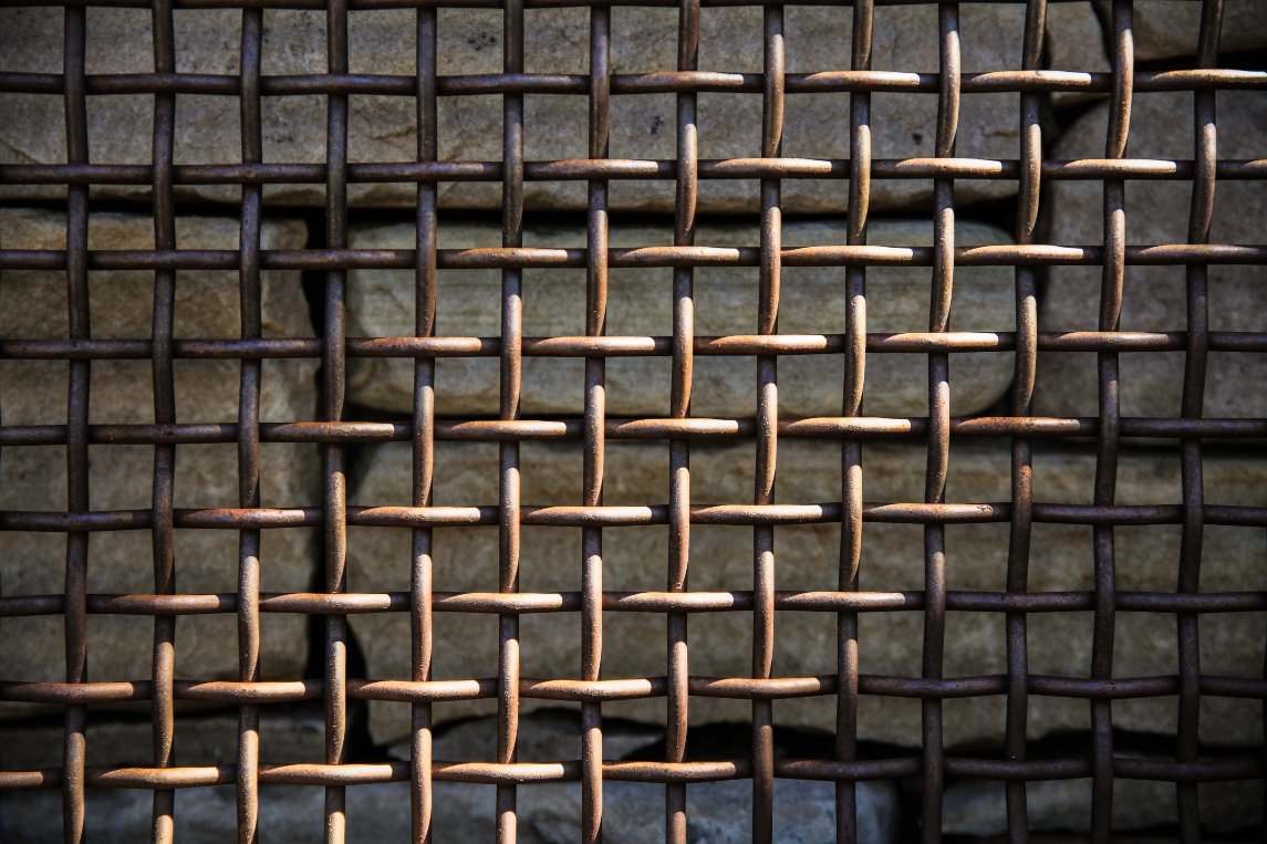 bronze-grid-on-brick