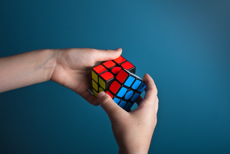 Person solving rubix cube