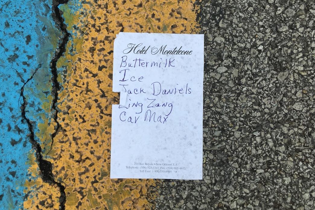 list-on-pavement