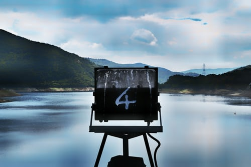 Sign marked with number four overlooking a lake