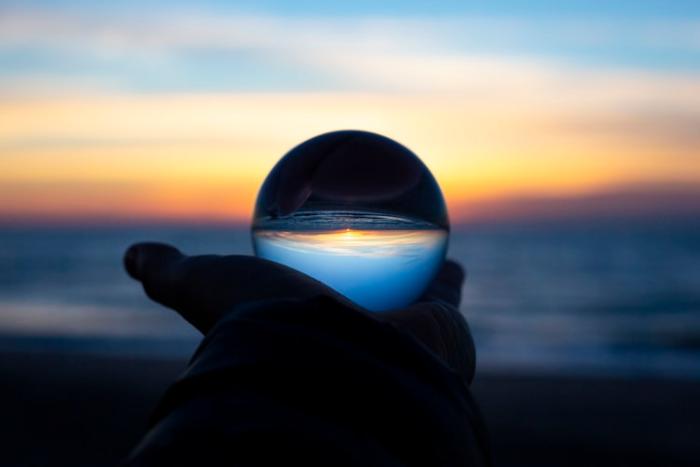 sunset on the beach through sphere