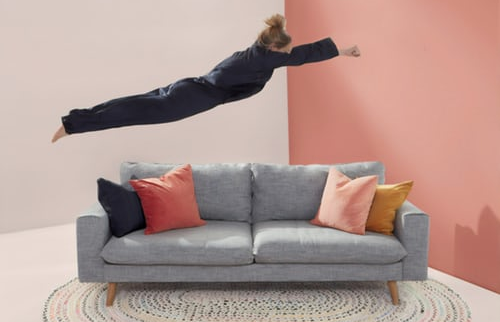 Woman leaping towards couch